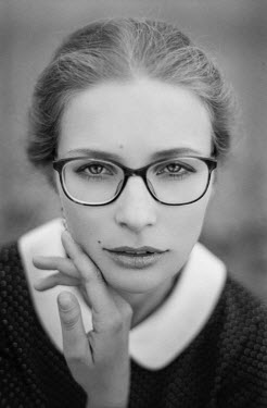 Nathalie Seiferth SERIOUS WOMAN WITH SPECTACLES OUTDOORS