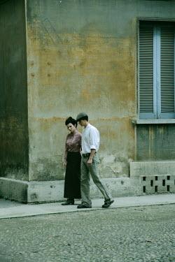 Giovan Battista D'Achille RETRO COUPLE WALKING IN STREET