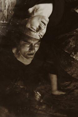 Giovan Battista D'Achille REFLECTION OF MALE HEAD IN WATER