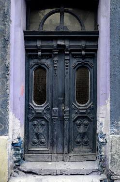 Jaroslaw Blaminsky BLUE DOORS IN OLD WEATHERED BUILDING