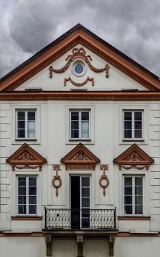 Jaroslaw Blaminsky EXTERIOR OF GRAND WHITE BUILDING WITH BALCONY