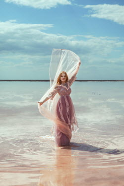 Katerina Klio WOMAN WITH PINK SILK STANDING IN SEA