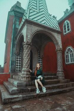 Katerina Klio WOMAN SITTING ON STEPS OUTSIDE CASTLE