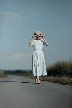 Magdalena Russocka young retro woman walking on country road