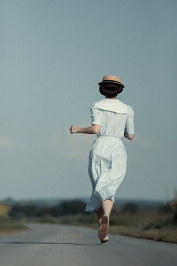 Magdalena Russocka young retro woman running on country road