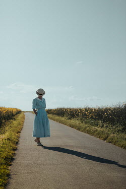 Magdalena Russocka young retro woman standing on country road