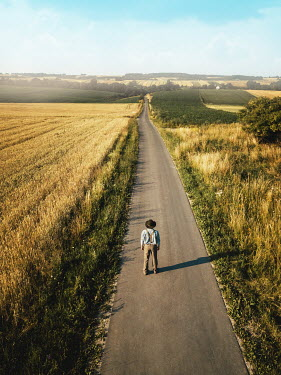 Magdalena Russocka young retro man standing on country road from above