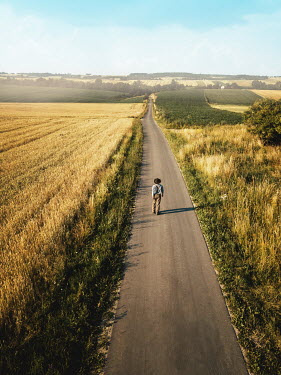 Magdalena Russocka young retro man walking on country road from above