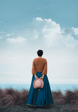 Mary Wethey HISTORICAL WOMAN WITH HAT WATCHING SEA