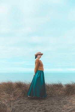 Mary Wethey HISTORICAL WOMAN WITH HAT STANDING BY SEA