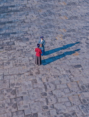 Mary Wethey TWO RETRO WOMEN STANDING ON FLAGSTONES