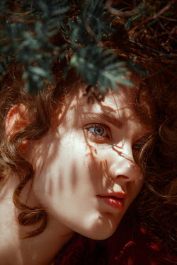 Nathalie Seiferth WOMAN WITH CURLY BROWN HAIR BY TREE