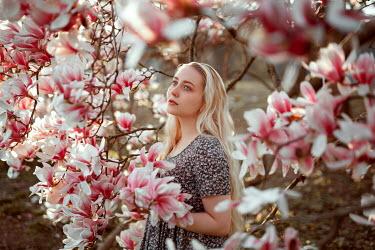 Nathalie Seiferth BLONDE WOMAN BY PINK MAGNOLIA TREE