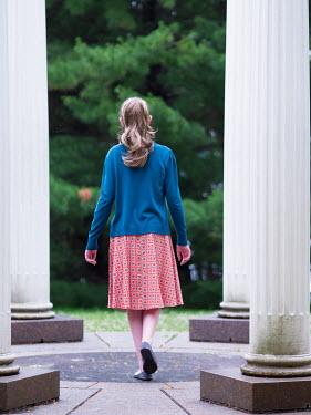 Elisabeth Ansley TEENAGE GIRL STANDING OUTSIDE BY PILLARS