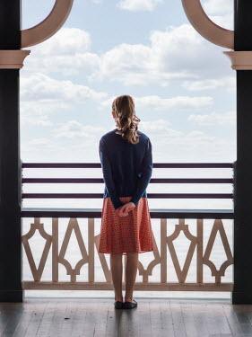 Elisabeth Ansley GIRL STANDING ON PIER WATCHING SEA