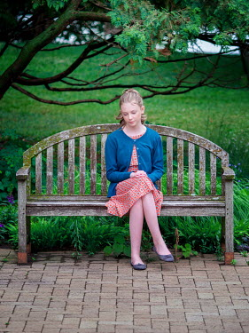 Elisabeth Ansley DAYDREAMING YOUNG GIRL SITTING ON PARK BENCH