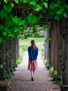 Elisabeth Ansley YOUNG GIRL WALKING THROUGH ARBOR