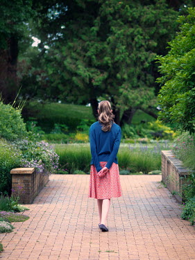 Elisabeth Ansley YOUNG GIRL WALKING ON PATH IN PARK