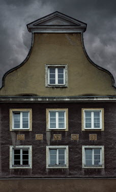 Jaroslaw Blaminsky EXTERIOR OF OLD BUILDING WITH STORMY SKY
