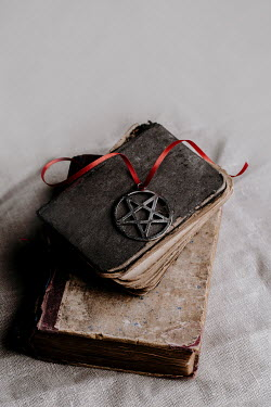 Joanna Jankowska PENTAGRAM WITH RED RIBBON ON OLD BOOKS