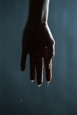 Magdalena Russocka close up of wet female hand with water dripping