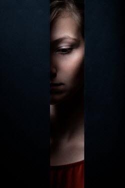 Magdalena Russocka sad young woman behind gap in wall