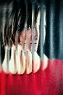 Magdalena Russocka young woman behind distorted glass