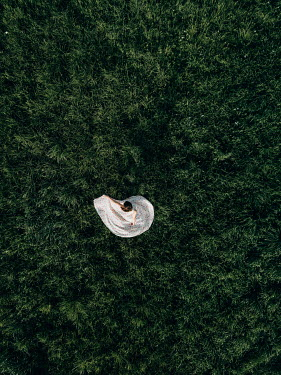 Magdalena Russocka young woman swirling on grass from above
