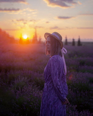 Svitozar Bilorusov WOMAN WITH HAT IN LAVENDER FIELD AT SUNSET