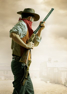 CollaborationJS COWBOY WITH RIFLE IN DUSTY STREET