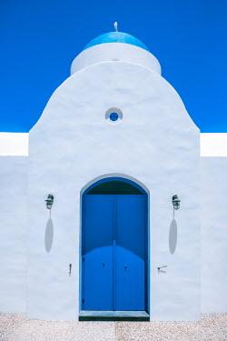 Evelina Kremsdorf WHITE BUILDING WITH BLUE DOORWAY
