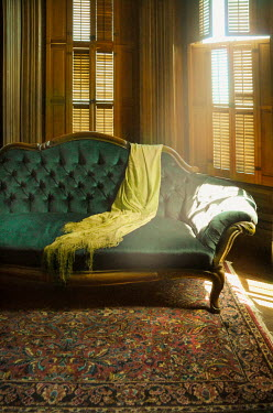 Jill Battaglia ANTIQUE SOFA WITH SHAWL IN SUNLIT HOUSE