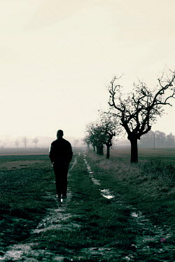 Joanna Jankowska SILHOUETTED MAN STANDING IN COUNTRYSIDE