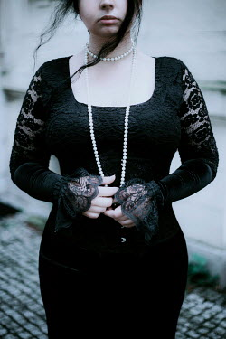 Joanna Jankowska GIRL IN BLACK LACE AND PEARLS OUTDOORS