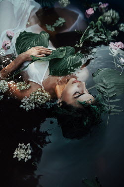 Jovana Rikalo WOMAN FLOATING IN WATER WITH FLOWERS
