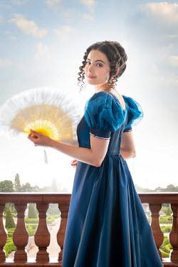 Lee Avison regency woman with a fan in the garden