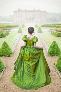 Lee Avison regency woman in green dress walking towards a mansion