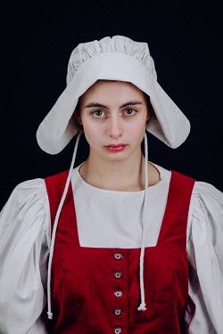 Magdalena Russocka close up of historical maid wearing white bonnet staring inside