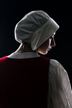 Magdalena Russocka close up of historical maid wearing white bonnet inside