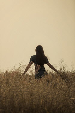 Magdalena Russocka teenage girl in meadow at sunset