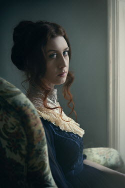 Natasza Fiedotjew edwardian woman in white lace collar sitting in flowery armchair