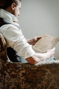 Natasza Fiedotjew edwardian man sitting in armchair and reading notebook