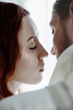 Natasza Fiedotjew close up of timeless couple embracing