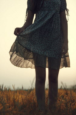 Magdalena Russocka close up of teenage girl in meadow at sunset