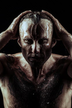 Magdalena Russocka close up of man with water pouring down his body