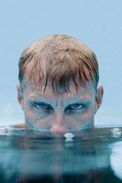 Magdalena Russocka man in pool with his head half submerged in water
