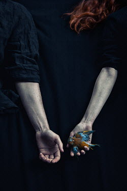 Natasza Fiedotjew woman's hand offering dead bird to man's hand