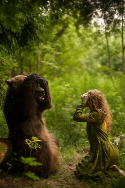 Alexandra Bochkareva GIRL AND BEAR SITTING WITH HANDS ON HEAD