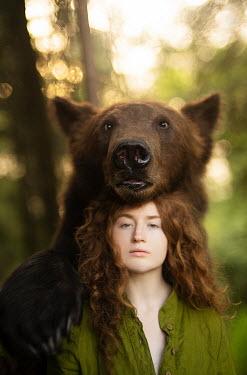 Alexandra Bochkareva BEAR LEANING ON HEAD OF WOMAN OUTDOORS