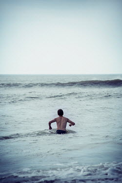Carmen Spitznagel MAN WADING INTO SEA WITH WAVES